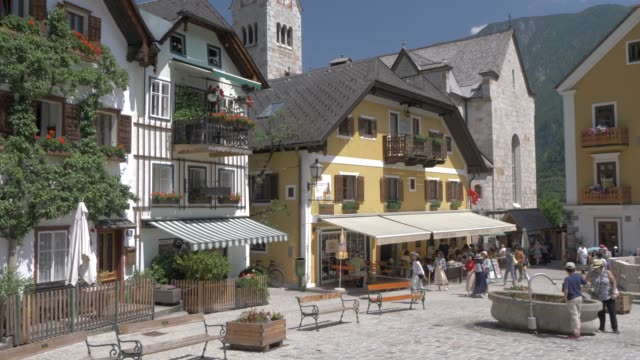 marktplatz in lakeside hallstatt village, unesco world heritage site, salzkammergut, austrian alps, austria, europe - park bench stock videos & royalty-free footage