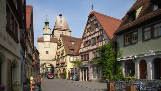 markus tower and röder arch (roeder arch). rothenburg ob der tauber, romantic road, franconia, bavaria, germany, europe. - romantic road germany stock videos and b-roll footage