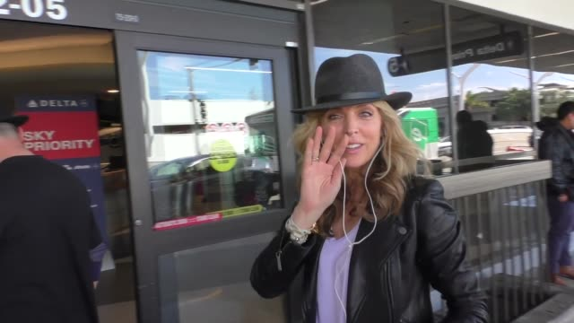 Marla Maples Tony Dovolani departing at LAX Airport in Los Angeles in Celebrity Sightings in Los Angeles
