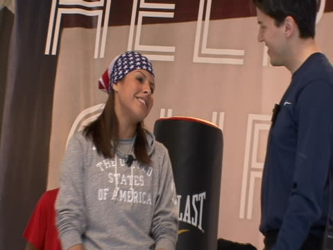 cu boxer marlen esparza on stage at countdown to olympics event in times square in new york city she's wearing an american flag bandana - sport stock videos & royalty-free footage