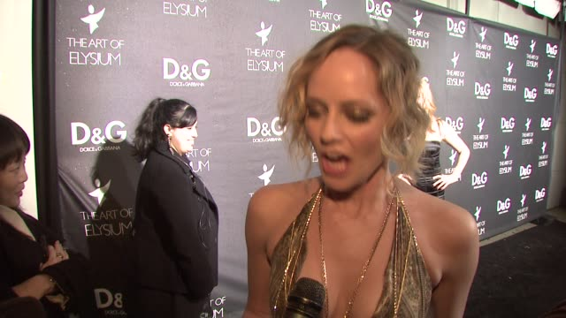marley shelton on why she loves dolce & gabbana, on what she's wearing, on the art of elysium, on what she wants for christmas, and on her plans for... - dolce & gabbana点の映像素材/bロール