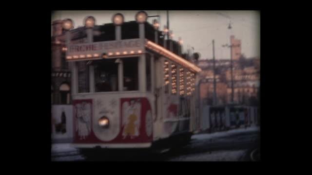 1968 marli tram and holiday season street life in zurich - trådbuss bildbanksvideor och videomaterial från bakom kulisserna