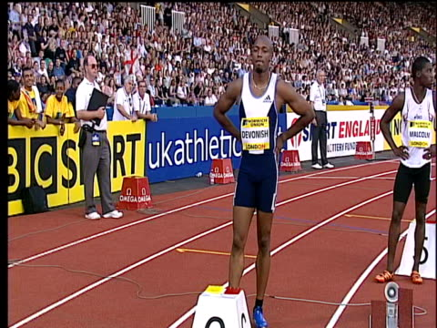 marlon devonish waves to cheering crowd men's 200m 2004 crystal palace athletics grand prix london - athleticism stock videos & royalty-free footage