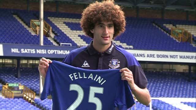 Marouane Fellaini shows off his Everton shirt to the Press on the day he signed a five year extension to his Everton contract at Goodison Park on...