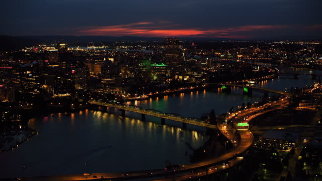 AERIAL Marquam, Hawthorne and Morrison Bridge across the Willamette River in Portland at night