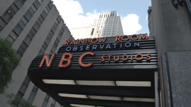 marquee entrance to new york city's nbc studio - rockefeller center video stock e b–roll
