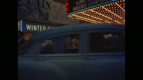 vídeos de stock, filmes e b-roll de ms marquee for the winter garden broadway theater with vehicles moving on street / new york city, new york state, united states - letreiro de teatro