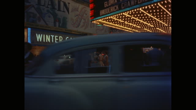 ms marquee for the winter garden broadway theater with vehicles moving on street / new york city, new york state, united states - ブロードウェイ点の映像素材/bロール