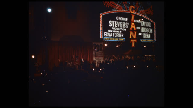 marquee of grauman's chinese theater advertising 'giant', crowds and traffic below. - tcl chinese theatre stock videos & royalty-free footage