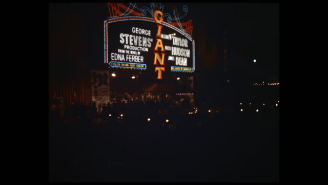 marquee of grauman's chinese theater advertising 'giant', crowds and traffic below. - film premiere stock videos & royalty-free footage