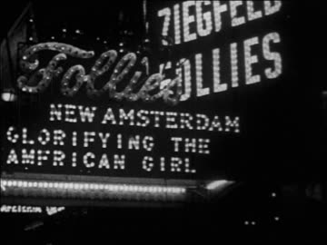 stockvideo's en b-roll-footage met b/w 1928 marquee of ziegfeld follies at new amsterdam theatre / nyc / newsreel - 1928