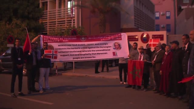 marrakesh tourist guides gather in front of the danish embassy in the city to denounce the murder of two young scandinavian hikers in southern... - murder stock videos & royalty-free footage