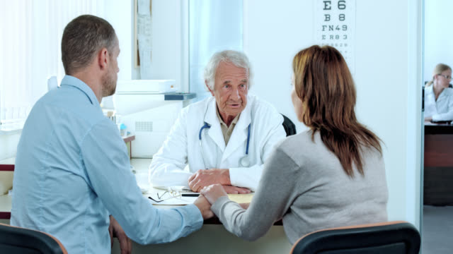 Married couple discussing the procedure with the attending physician
