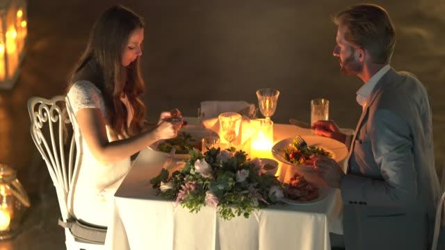 married couple enjoying romantic dinner - お食事デート点の映像素材/bロール
