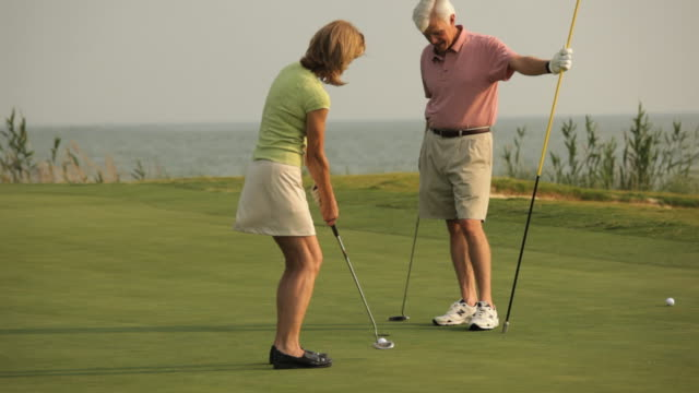 ms, tu, married couple playing golf on putting green, eastville, virginia, usa - eastville stock videos and b-roll footage