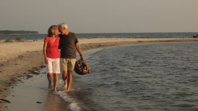 ms, pan, married couple walking together on beach, eastville, virginia, usa - eastville stock videos and b-roll footage
