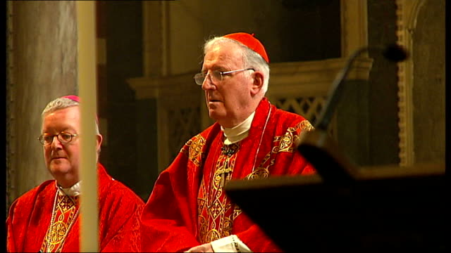 married couples celebrate at westminster cathedral mass; cardinal cormac murphy-o'connor leading service to celebrate marriage sot - westminster cathedral stock videos & royalty-free footage