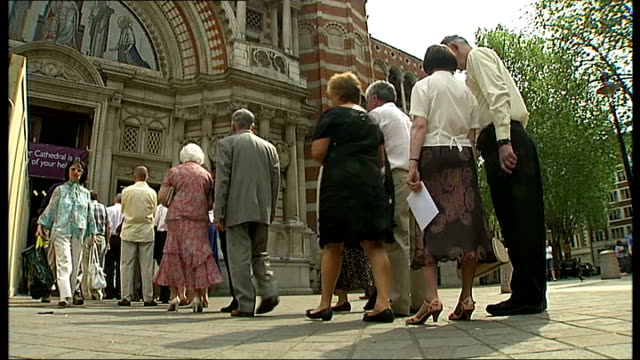 married couples celebrate at westminster cathedral mass; england: london: westminster cathedral: ext various of people queuing to enter westminster... - westminster cathedral stock videos & royalty-free footage