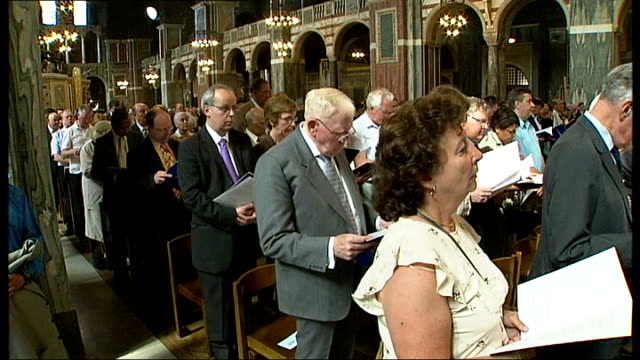 Married couples celebrate at Westminster Cathedral mass Female church member leading congregation hymn congregation singing response SOT / Gold...
