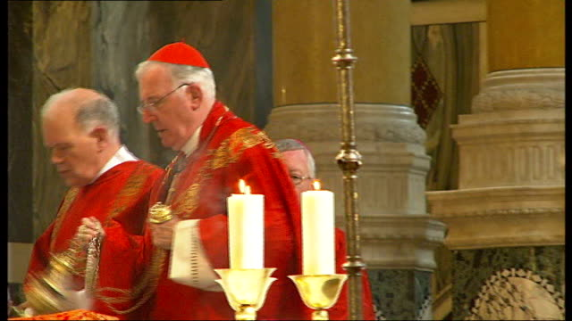 married couples celebrate at westminster cathedral mass; int cardinal cormac murphy o'connor swinging incense during mass general side views of... - westminster cathedral stock videos & royalty-free footage