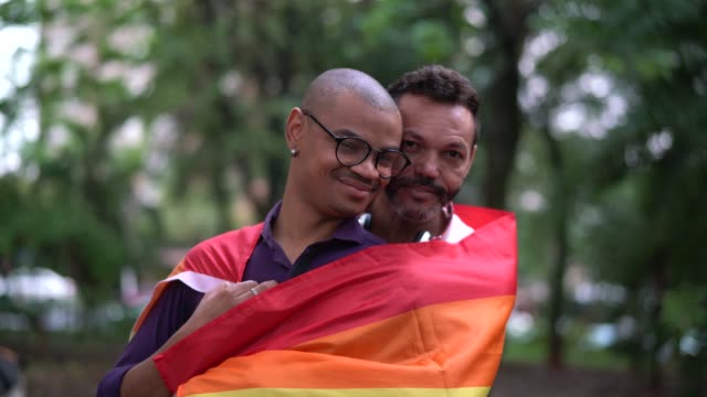 married gay couple portrait - rainbow flag stock videos & royalty-free footage