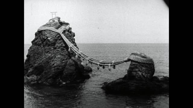 """married"" meoto-iwa rocks at futamiokitama shrine;1964 - shinto shrine stock videos & royalty-free footage"