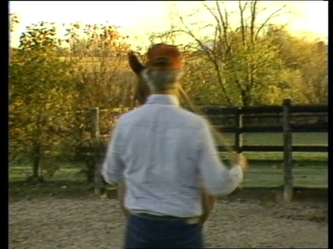 wisconsin ext ms john neihof walks lr through gate ms horse neihof up to it places rope round neck and walks rl gts horses in paddock ms horse in... - ウマ科点の映像素材/bロール