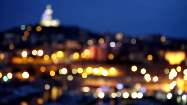 marseille city with old vieux port night blur background - notre dame de la garde marseille stock videos and b-roll footage