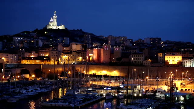 marseille city with old vieux port night - notre dame de la garde marseille stock videos and b-roll footage