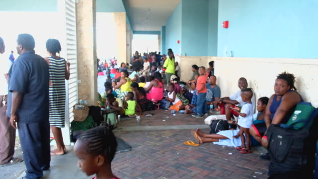 marsh harbor residents wait at leonard m thompson international airport while trying to evacuate the island on september 5 2019 in great abaco island... - evacuation stock videos & royalty-free footage