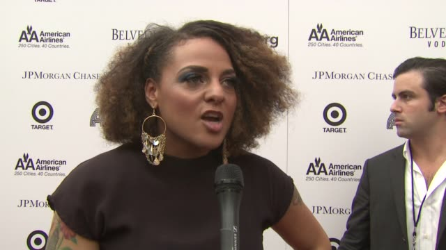 vídeos de stock e filmes b-roll de marsha ambrosius talks about singing a song she wrote for michael jackson and happy to be paying homage to him she is a big aretha fan and may pass... - benefit concert