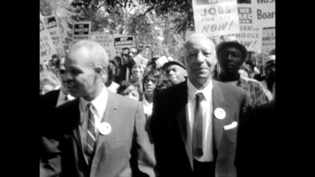 vídeos de stock e filmes b-roll de / marshal clearing street for front line of march to pass through / a philip randolph marching march on washington begins on august 28 1963 in... - 1963