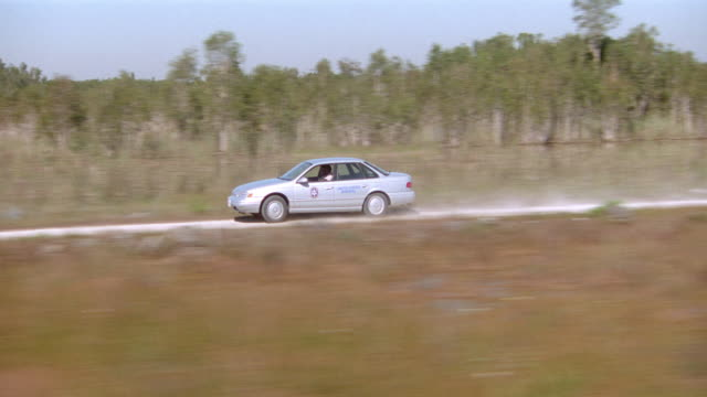 a u.s. marshal drives fast through a swamp. - wetland stock videos & royalty-free footage