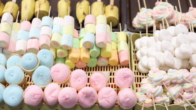 marshmallows and thai desserts are in the tray. - marshmallow video stock e b–roll