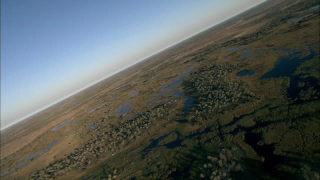 Marshy areas stretch across African grasslands. Available in HD.