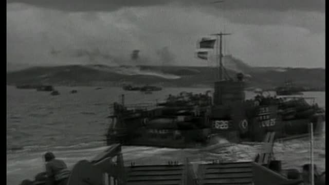 marsie taylor amongst dday veterans awarded the legion d'honneur lib / france normandy ext b/w boats approaching shore on d day b/w troops on board... - アロマンシェス点の映像素材/bロール