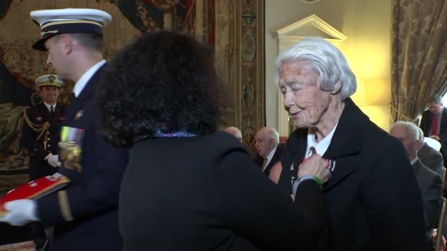 marsie taylor amongst dday veterans awarded the legion d'honneur **beware england london french embassy int sylvie berman presenting the legion... - アロマンシェス点の映像素材/bロール