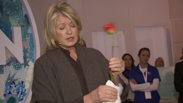 martha stewart shows how to rid a rose of it's thorns at martha stewart transforms grand central terminal into multimedia celebration of american... - martha stewart stock videos & royalty-free footage