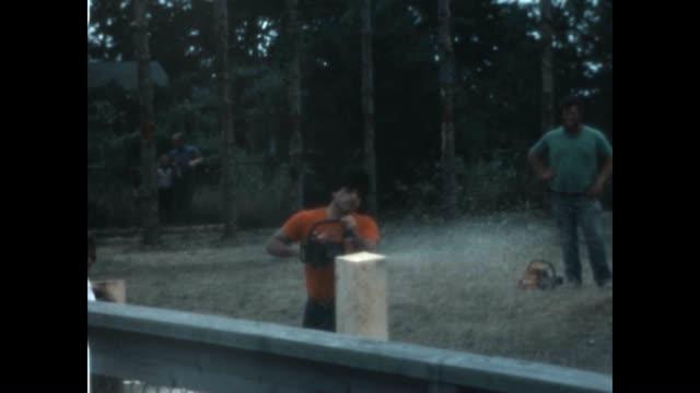 vidéos et rushes de martha's vineyard agricultural society fair featuring lumber jacking competition. - bûcheron