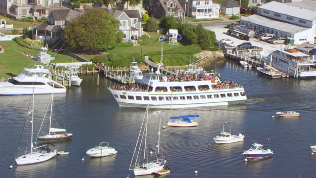 ws zi aerial pov martha's vineyard island with island queen ferry and other boats at harbour / falmouth, massachusetts, united states - other stock videos & royalty-free footage