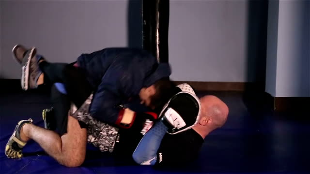 martial art fight - mixed martial arts stock videos and b-roll footage