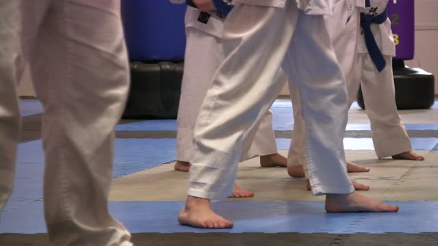 karate kids. martial art training school. boys & girls. - martial arts stock videos & royalty-free footage