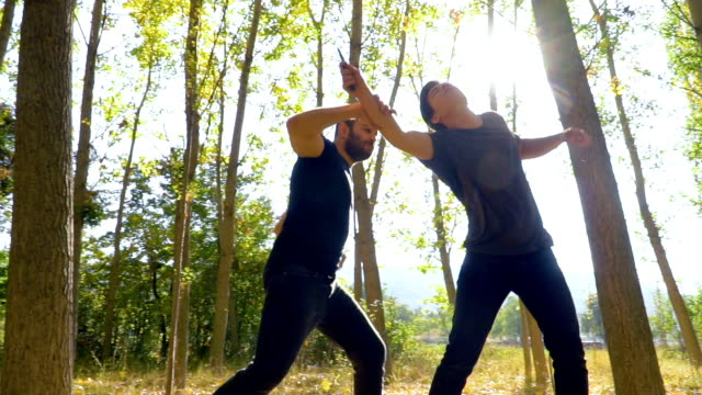 martial arts instructor demonstrating self defense against a knife attack - knife crime stock videos & royalty-free footage