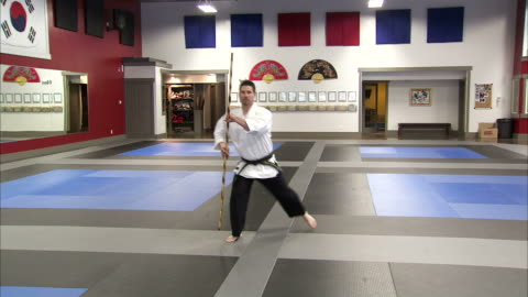 ws ds martial arts instructor using bo staff / springville, utah, usa - springville utah stock videos & royalty-free footage