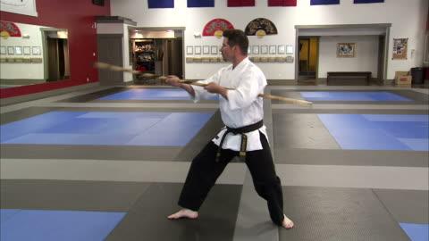 ws pan martial arts instructor using bo staff / springville, utah, usa - springville utah stock videos & royalty-free footage