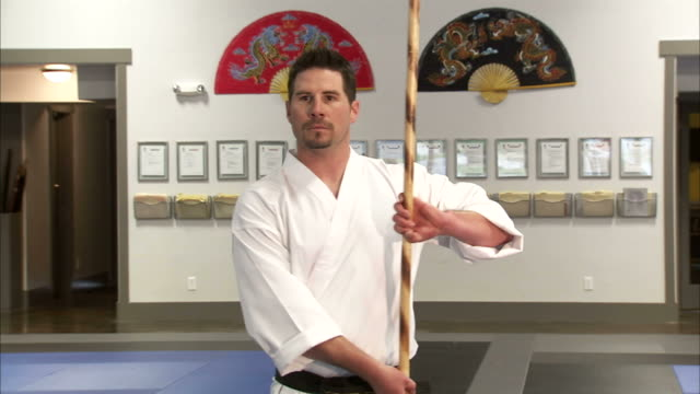 ms martial arts instructor using bo staff / springville, utah, usa - springville utah stock videos & royalty-free footage