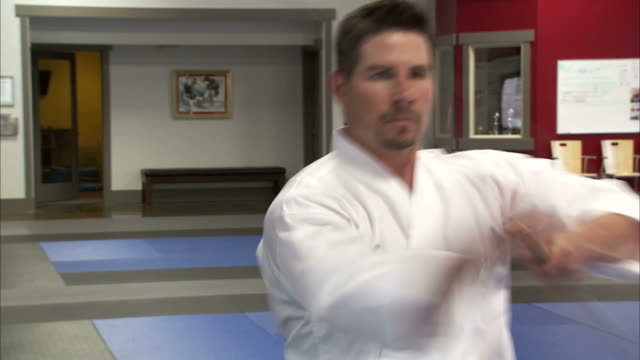 cu martial arts instructor using bo staff / springville, utah, usa - springville utah stock videos & royalty-free footage