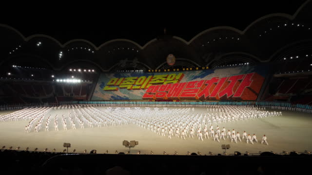 martial arts perfomers during mass games in pyongyang, north korea, dprk. wide shot - north korea stock videos & royalty-free footage
