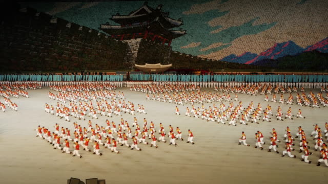 martial arts perfomers during mass games in pyongyang, north korea, dprk. medium shot - north korea stock videos & royalty-free footage