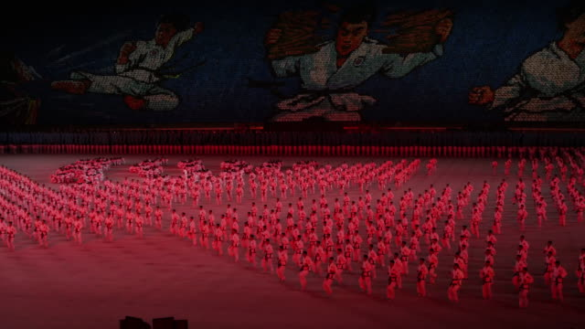 martial arts perfomers during mass games in pyongyang, north korea, dprk. medium shot - spoonfilm stock-videos und b-roll-filmmaterial